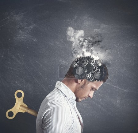 Photo for Concept of stress with gear in the head of a businessman - Royalty Free Image