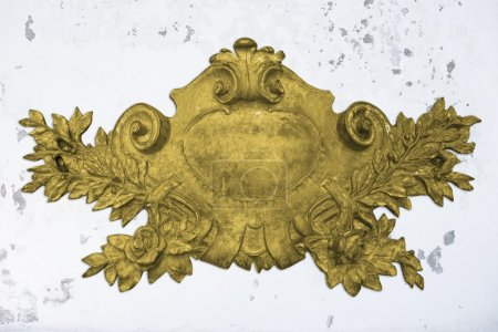 Antique golden emblem