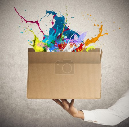 Photo for Man holding a creative business box - Royalty Free Image