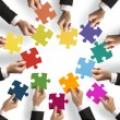 Teamwork and integration concept with puzzle piece...