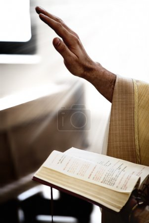 Photo for Hand of priest that holds Bible - Royalty Free Image