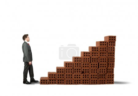 Photo pour Concept de construction d'une entreprise avec des statistiques en brique - image libre de droit