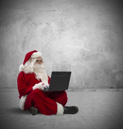Photo for Concept of modern Santa Claus with laptop - Royalty Free Image