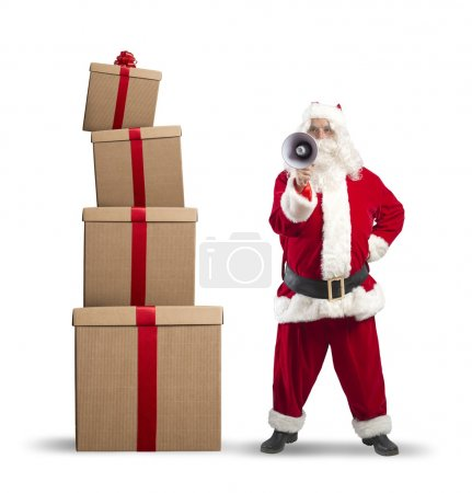 Photo for Santa Claus with megaphone with stack gifts - Royalty Free Image