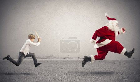 Angry child with Santa Claus