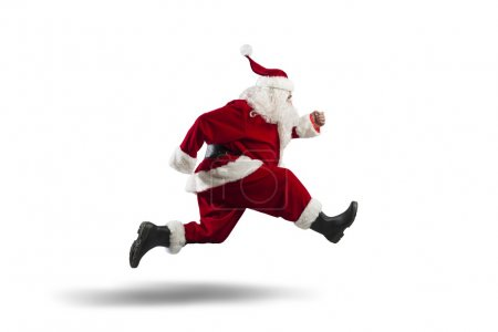 Photo for Running Santa Claus isolated on white background - Royalty Free Image