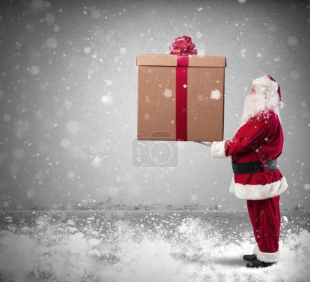 Photo for Magic Christmas with Santa Claus with a big gift - Royalty Free Image