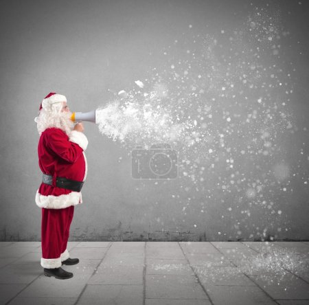 Photo for Santa Claus with megaphone with flying snow - Royalty Free Image