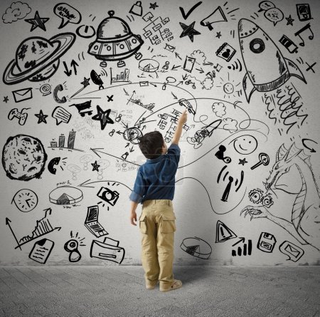 Photo for Concept of small genius with kid and varius drawings - Royalty Free Image