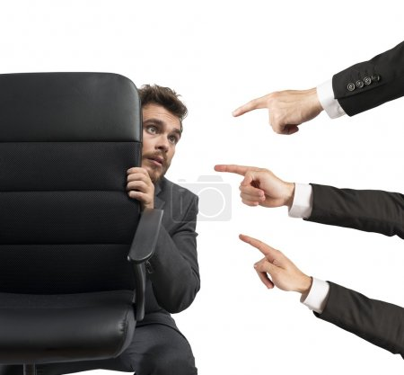 Photo for Concept of businessman culprit behind a chair - Royalty Free Image