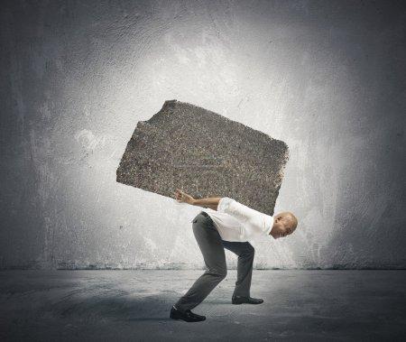 Photo pour Concept de stress et de carrière difficile un homme d'affaires - image libre de droit