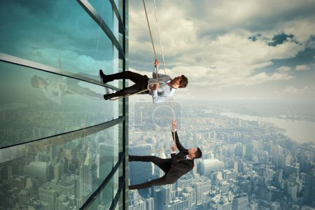 Photo for Concept of competition with climbing businessman - Royalty Free Image