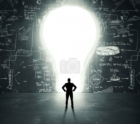 Photo for Businessman in front of a bright lightbulb door - Royalty Free Image
