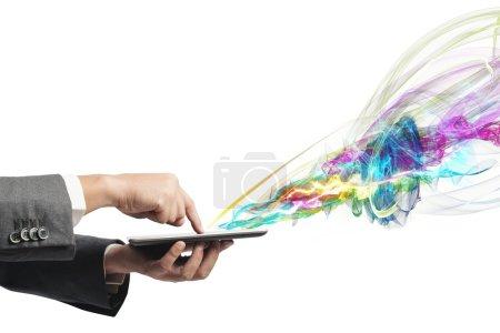 Photo pour Homme d'affaires travaillant avec tablette à écran tactile créative - image libre de droit