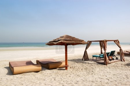 Photo for Beach with hut and sunbeds of the luxury hotel, Ajman, UAE - Royalty Free Image