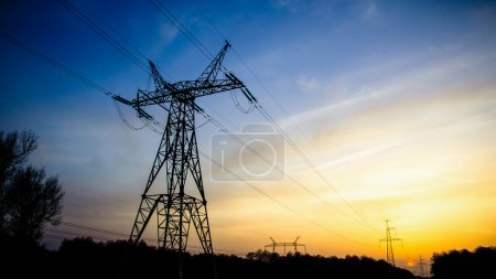 High-voltage transmission power towers silhouette