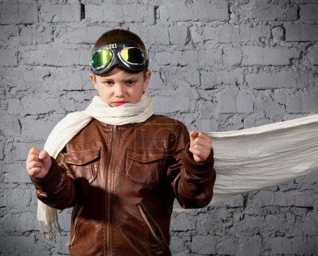 Little boy dreaming of becoming a pilot