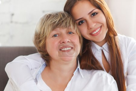 Portrait of a mature grandmother and teen granddaughter and teen