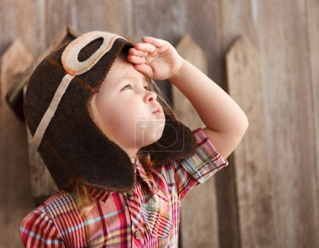 Happy kid playingin pilot helmet