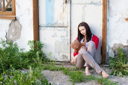 Photo for Teenage girl with a toy outdoors - Royalty Free Image