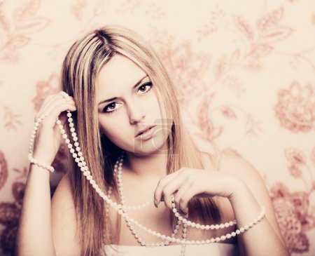 beautifu blonde woman with pearl beads