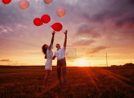 Photo for Wedding couple with balloons outdoor - Royalty Free Image