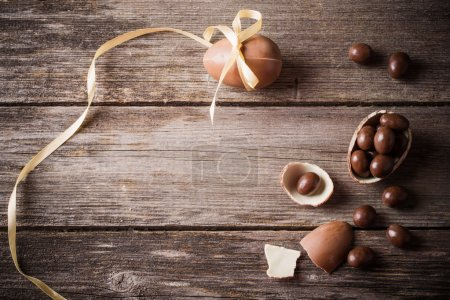 Photo for Chocolate Easter Eggs Over Wooden Background - Royalty Free Image