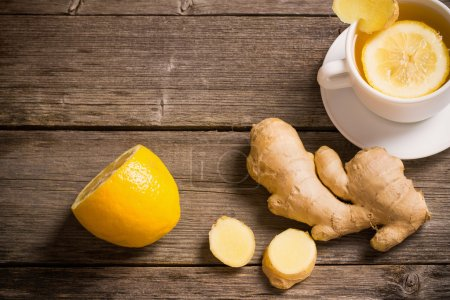 Photo for Ginger tea with lemon in a white cup - Royalty Free Image