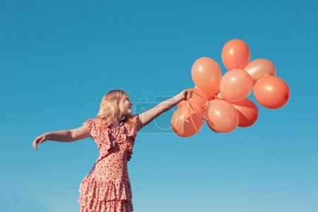 Little girl  outdoors with balloons