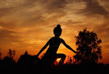 Little girl at sunset
