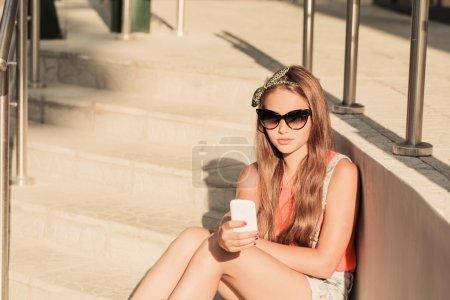 Teenage girl on her mobile phone
