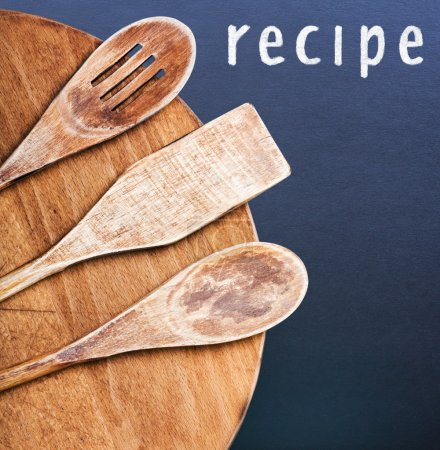 Kitchen utensils and an inscription in chalk recipe