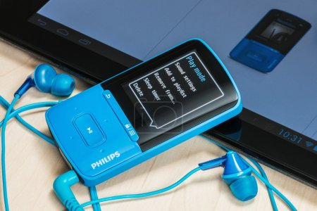 MP4 Media Player included with Philips headphones on the table