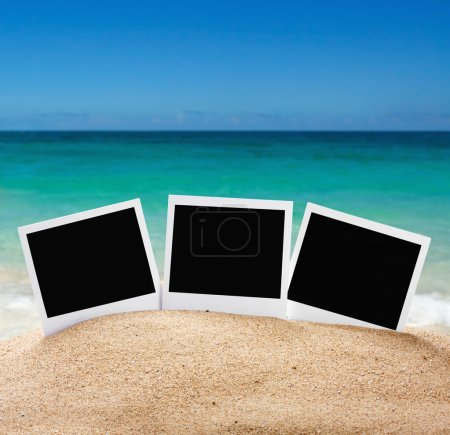 Photo frames on sea sand