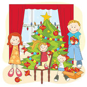 The happy family dresses up a Christmas tree
