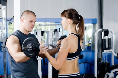 Woman with trainer in sports club