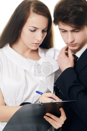 The businessman and businesswoman with clipboard