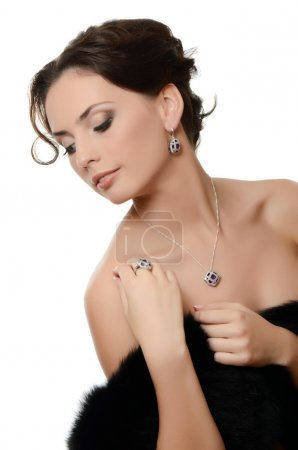 The beautiful woman with expensive jewelry