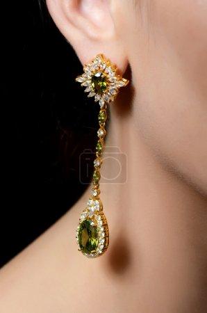 Female ear  in jewelry earrings