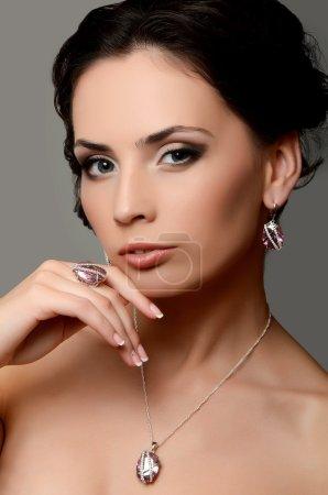 Woman in jewelry earrings