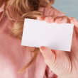 Image of business woman holding her visiting card...