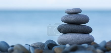 Photo for Stack of round smooth stones on a seashore - Royalty Free Image