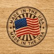 Made in the USA rubber stamp on wooden background...