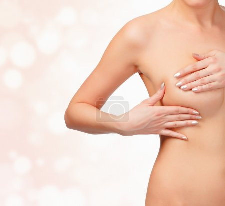 Woman contols her breast for cancer