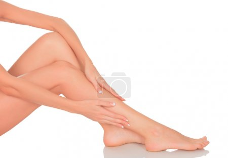 Perfect long female legs against white background