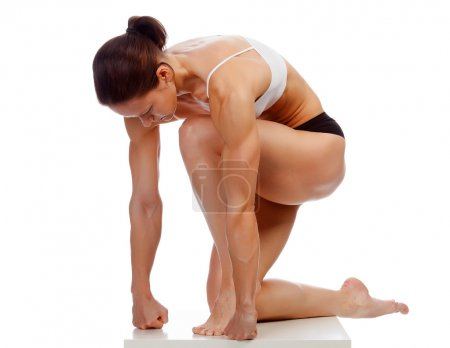 Muscular strong woman on a white background