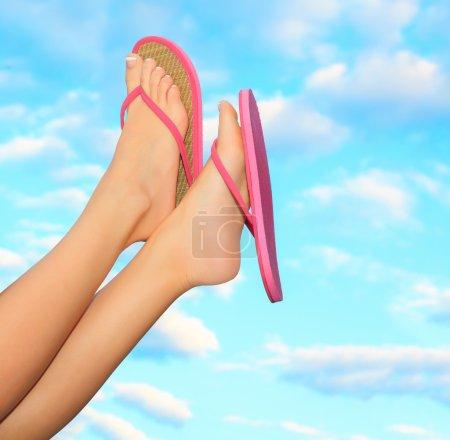 Female legs in pink sandals