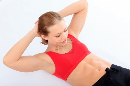 woman doing sit-ups exercise abdominal workout