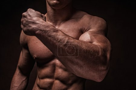 Photo for Muscled male model with strong arms - Royalty Free Image
