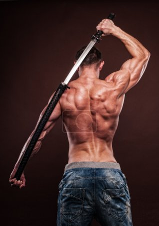Photo for Shirtless young man posing with katana sword - Royalty Free Image